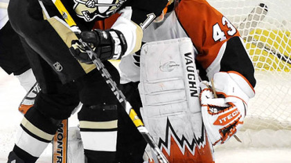Penguins Ryan Malone tries to get in front of Flyers Martin Biron in the first period Sunday.
