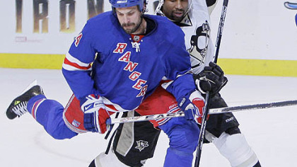 New York Rangers&#039; Jason Strudwick, left, battles to clear the puck against Pittsburgh Penguins&#039; Georges Laraque in the first period during Game 4 of an NHL Eastern Conference semifinal hockey playoff series Thursday, May 1, 2008 at Madison Square Garden in New York.