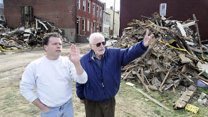 Pitt professor emeritus and meteor expert William Cassidy, right, looks with Matt Grebner toward Mr. Grebner''s Spring Hill home. The site of two destroyed North Side homes is behind Mr. Grebner, who thinks a meteorite may have caused the damage. Dr. Cassidy thinks: unlikely.