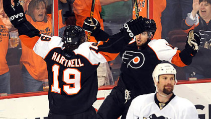 Flyers Joffrey Lupel, against the glass, celebrates his first-period goal.