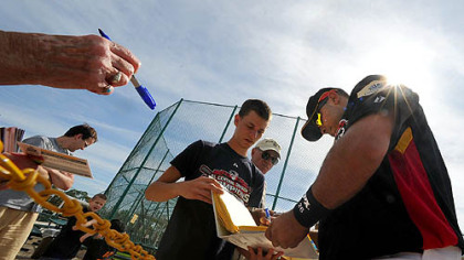 Pirates catcher Ronny Paulino signs autographs for fans during the first day of workouts for pitcher and catchers yesterday at Pirate City in Bradenton, Fla.