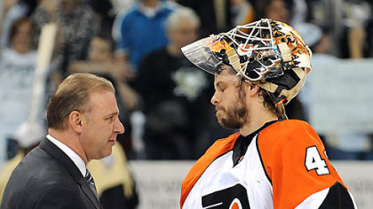 Penguins head coach Michel Therrien shakes hands with Flyers goalie Martin Biron.