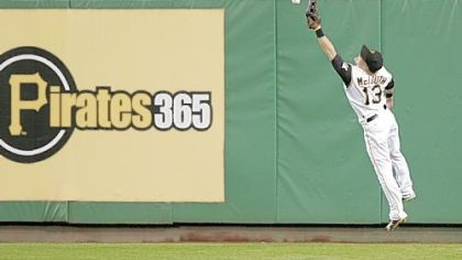 Center fielder Nate McLouth attempts to corral a ball hit by Los Angeles' Casey Blake as it caroms off the wall last night at PNC Park. Blake wound up with a triple -- one of his three hits.