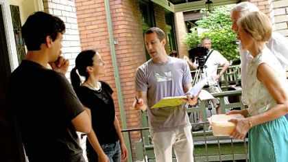 "Jeremy Braverman, center, directs actors, from left, Sam Turich, Carla Bianco, Bingo O'Malley and Rita Gob during the production of ""Regent Square,"" a film for the Neighborhood Narrative project. Cinematographer John Rice is in the background."