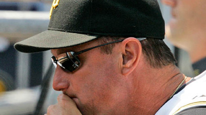 Pirates manager John Russell looks on from the dugout during a 3-1 loss to the San Diego Padres yesterday at PNC Park.