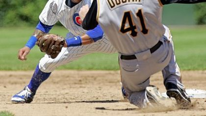 Cubs second baseman Ronny Cedeno prepares to tag out Ryan Doumit on an attempted steal of second  in the third inning.