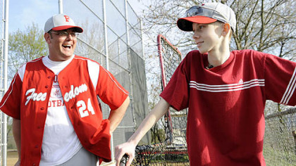 John Challis talks with Freedom High School head baseball coach Steve Wetzel after a game April 24.