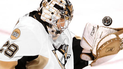 Penguins goalie Marc-Andre Fleury makes a save against the Flyers&#039; Mike Richards.