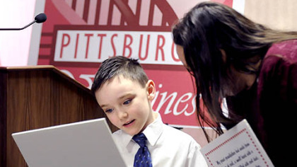 Cameron Greenaway, 7, of Baldwin shows his &quot;Pittsburgh Valentine&quot; to Toni Staab of McKees Rocks during a luncheon with Mayor Luke Ravenstahl at the City-County Building.
