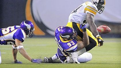 The Vikings' Kevin Williams knocks the ball loose from the grasp of Steelers Rashard Mendenhall in the first half of the preseason game in Minneapolis.