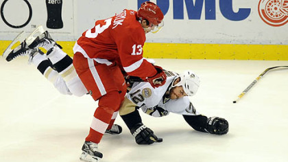 Ryan Malone is upended by the Red Wings' Pavel Datsyuk.