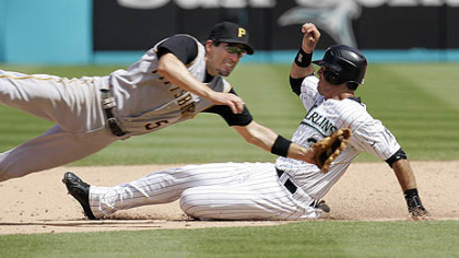 Marlins&#039; Jorge Cantu slides safely past Pirates second baseman Chris Gomez with a stolen base yesterday in the eighth inning. The Pirates won, 9-2.
