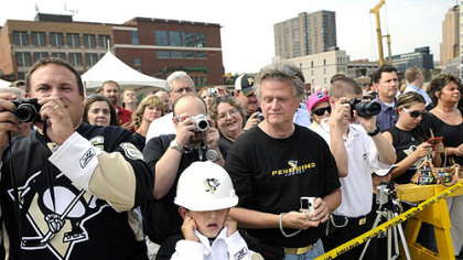 Justin Hackman, 8, of Baldwin, anticipates a loud noise yesterday during groundbreaking for the new Penguins arena.