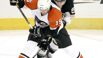 Penguins' Kris Letang, rear, gets his stick behind the skate of the Flyers' Joffrey Lupul in the game Sunday. The Penguins wrap up the regular season with a home-and-home series against the Flyers.