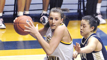 West Virginia's Meg Bulger drives against Pitt's Karlyle Lim.