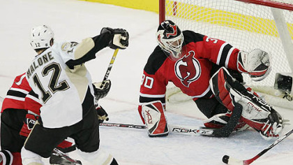 Ryan Malone scores off a rebound against New Jersey&#039;s Martin Brodeur.