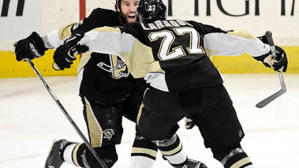 Penguins Maxime Talbot celebrates his third-period goal against the Flyers with teammate Georges Laraque Sunday.
