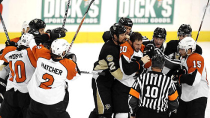 Penguins and Flyers fight during the second period Sunday.