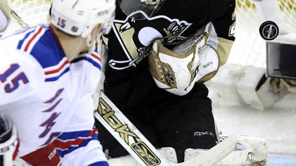 Penguins Marc-Andre Fleury makes a save in front of Rangers Blair Betts in the first period Friday night at Mellon Arena.