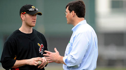 Pirates chairman Robert Nutting catches up with Jason Bay at camp this week.