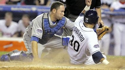 Tampa Bay Rays' Dioner Navarro (30) of the American League is out at the plate after a throw from center field by the Pirates' Nate McLouth in the 11th inning. National League catcher Russell Martin of the Los Angeles Dodgers applies the tag that kept the NL alive for four more innings.