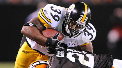 Willie Parker is tackled by the Browns' Mike Adams.