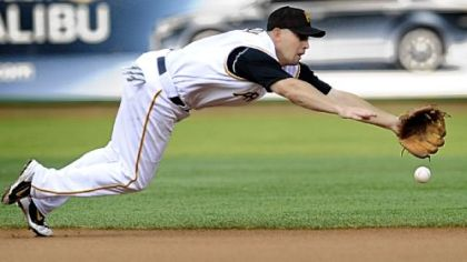 Pirates Jack Wilson can't quite come up with a ground ball hit by Colorado's Willy Taveras in the first inning.