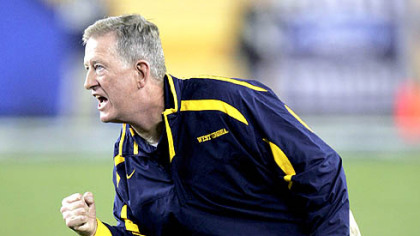 Bill Stewart exorts the Mountaineers last night in the Fiesta Bowl against Oklahoma. WVU named Stewart its new head football coach at a news conference this morning.