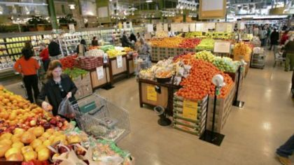 Shoppers browse the fresh produce at the second, smaller Cleveland-area store that Whole Foods acquired last year.