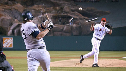 Jason Giambi's broken bat sails at Angels pitcher John Lackey a few seasons ago.
