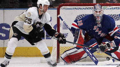 New York Rangers goalie Henrik Lundqvist, of Sweden, defends the net as the Penguins' Maxime Talbot (25) reaches for a rebound during the second period of their NHL hockey game at Madison Square Garden in New York last night.