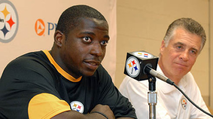 Rookie running back, Rashard Mendenhall talks with the media with Art Rooney Jr. at St. Vincent College at the start of training camp yesterday.