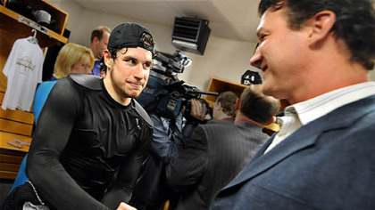 Penguins Sidney Crosby is congratulated by owner Mario Lemieux.