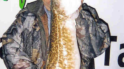 Bill Davis of Kane, Pa., holds a 411/2-inch burbot caught in Lake Erie.