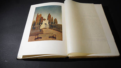 "A book, ""Italian Villas and Their Gardens,"" by Edith Wharton with pictures by Maxfield Parrish."