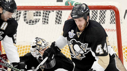 The Penguins' Brooks Orpik (44) sends the Red Wings' Valtteri Filppula to the ice Wednesday at Mellon Arena.