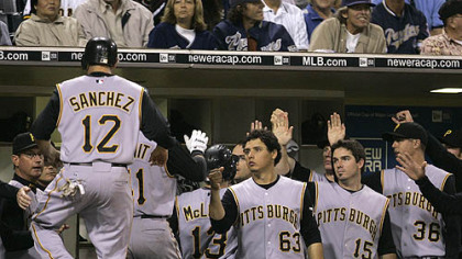 The Pirates' Freddy Sanchez (12) is greeted at the dugout after Doumits' three-run home run against the San Diego Padres in the sixth inning of last night's game Friday in San Diego.
