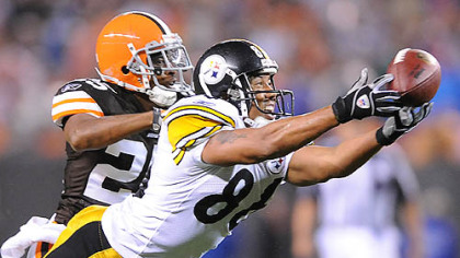Hines Ward stretches out for a pass from Ben Roethlisberger past the Browns' Terry Cousin.