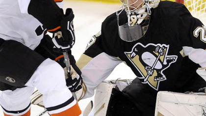The Penguins&#039; Marc-Andre Fleury makes a save on Flyers R.J. Umberger in the first period tonight in Game 1 of the Eastern Conference final series at Mellon Arena.