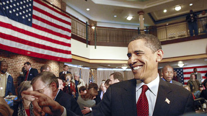 Sen. Barack Obama greets supports after holding a town hall meeting at Rossin Campus Center at Washington and Jefferson College in Washington, Pa., yesterday. The senator wears an American flag pin in his lapel after it was given to him by a disabled veteran. Radio and cable news commentators pounced on the senator when he was seen not wearing such a pin during the campaign in Iowa.