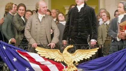 In &quot;John Adams,&quot; Paul Giamatti, left center, portrays John Adams and David Morse is George Washington.