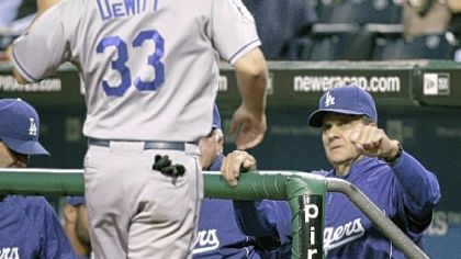 Dodgers manager Joe Torre welcomes Blake DeWitt back to the dugout after  DeWitt scored in the four-run Dodgers second inning.
