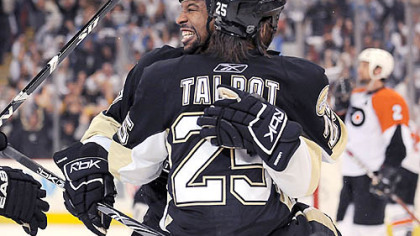 Penguins Georges Laraque congratulates Max Talbot after scoring the winning goal.