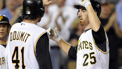 Ryan Doumit greets Adam LaRoche after hitting a grand slam off Dodgers starting pitcher Chad Billingsley in the fifth inning last night at PNC Park.