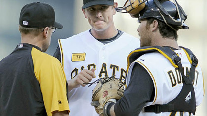 Pirates pitching coach Jeff Andrews and Ryan Doumit talk with Pirates pitcher Jimmy Barthmaier in the first inning against the Rays Friday night.