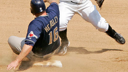 Second baseman Luis Rivas, right, turns a seventh inning double play over San Diego Padres&#039; Chase Headley at PNC Park yesterday.