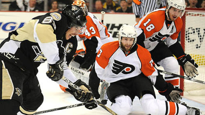 Penguins Sidney Crosby takes shot on Flyers goalie Martin Biron in the first period.