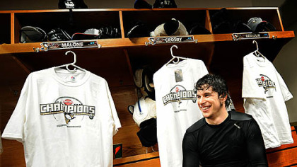 Penguins Sidney Crosby surrounded by Championship t-shirts.