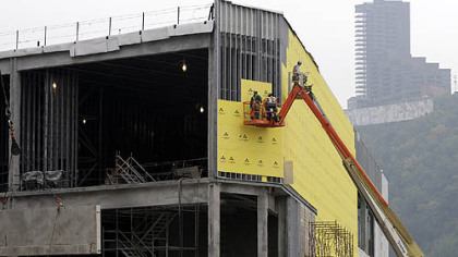 Construction crews work on the exterior of the North Shore casino yesterday.