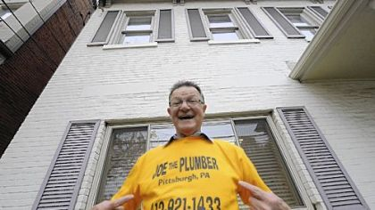 Joseph Bruni shows off his T-shirt outside his office on Greentree Road in the West End yesterday.